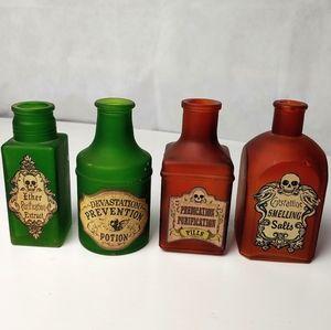 Four decorative Halloween bottles